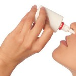 The woman drips drops for a nose for fast recover